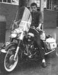 Earle Craigie on his Harley Davidson in 1963 in front of the Cambridge YMCA where he worked part-time while attending No