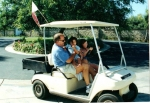 'Ceg' teaching grand daughter to drive golf cart.